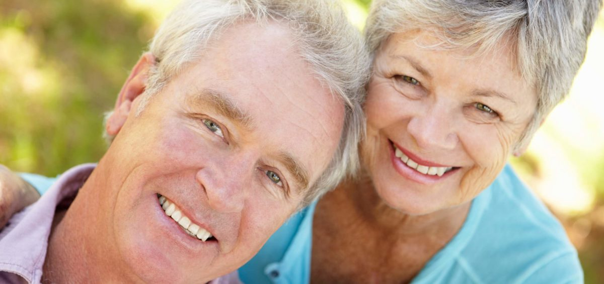 Senior Couple Smiling with Beautiful Teeth