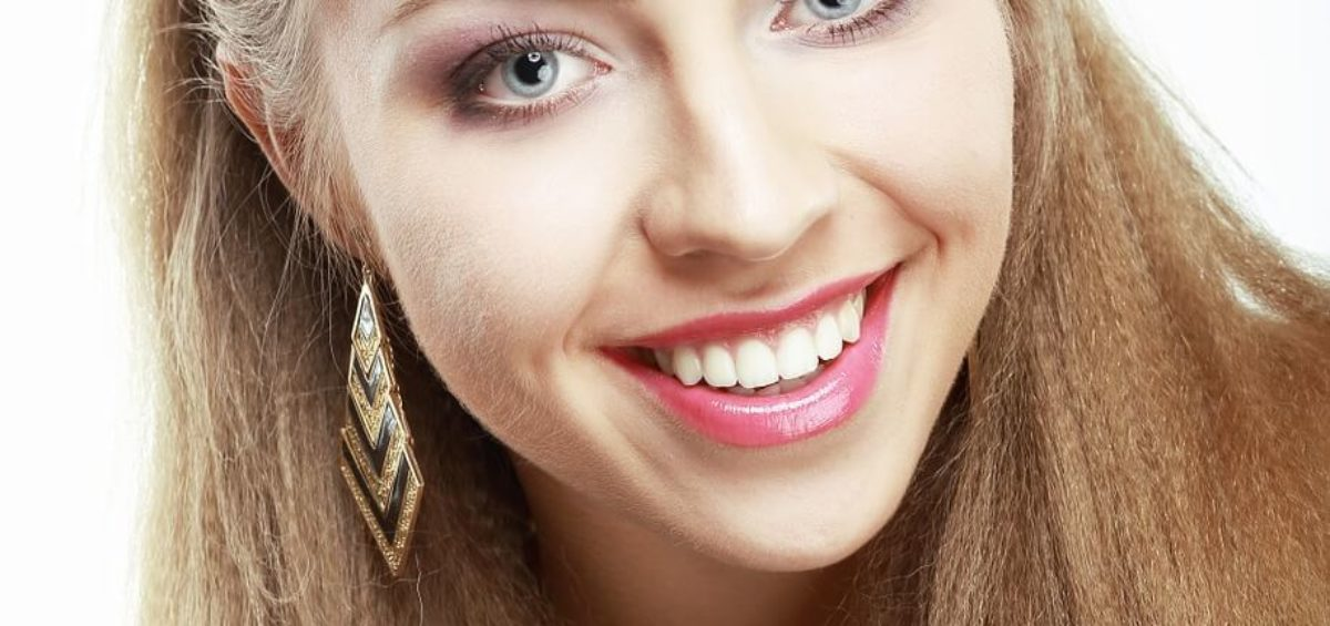 Young Blonde Woman Smiling with Beautiful Teeth