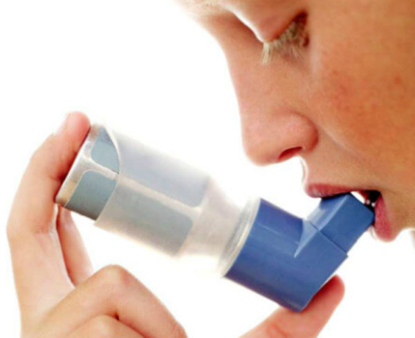 Kid Using Inhaler